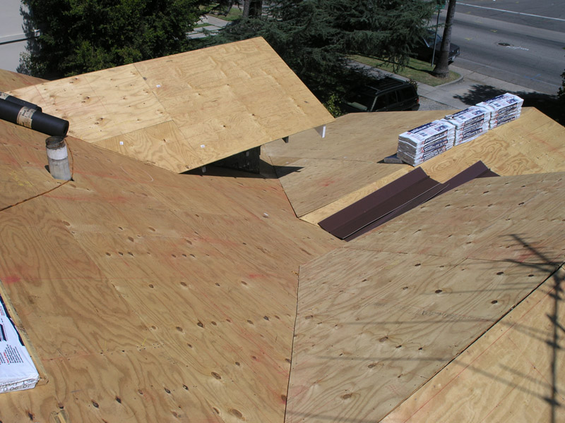 Front Dormers And Porch Over Main Roof With Plywood Installed And Some Of  The Roofing Materials