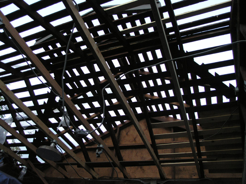 California Framing forms pattern of dark lines on dusk sky. 1940's garage addition over 1912 carriage house rafters, OLYMPUS C-8080