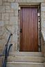 rear side door, NE corner of bldg, exterior view