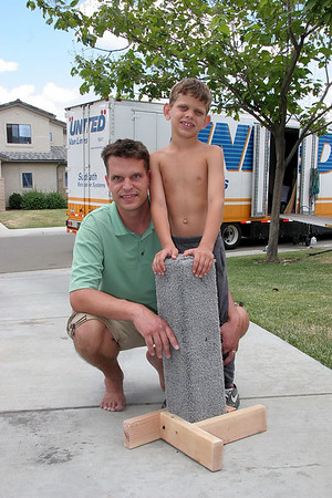 Daddy and Tyler build a scratching post