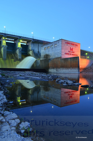 I thought I would try a portrait perspective to give a bigger sky relative to the dam and tower.  Having no wind helped the reflections to remain really clear.