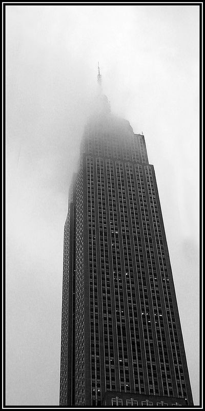 Empire State Building enveloped in fog