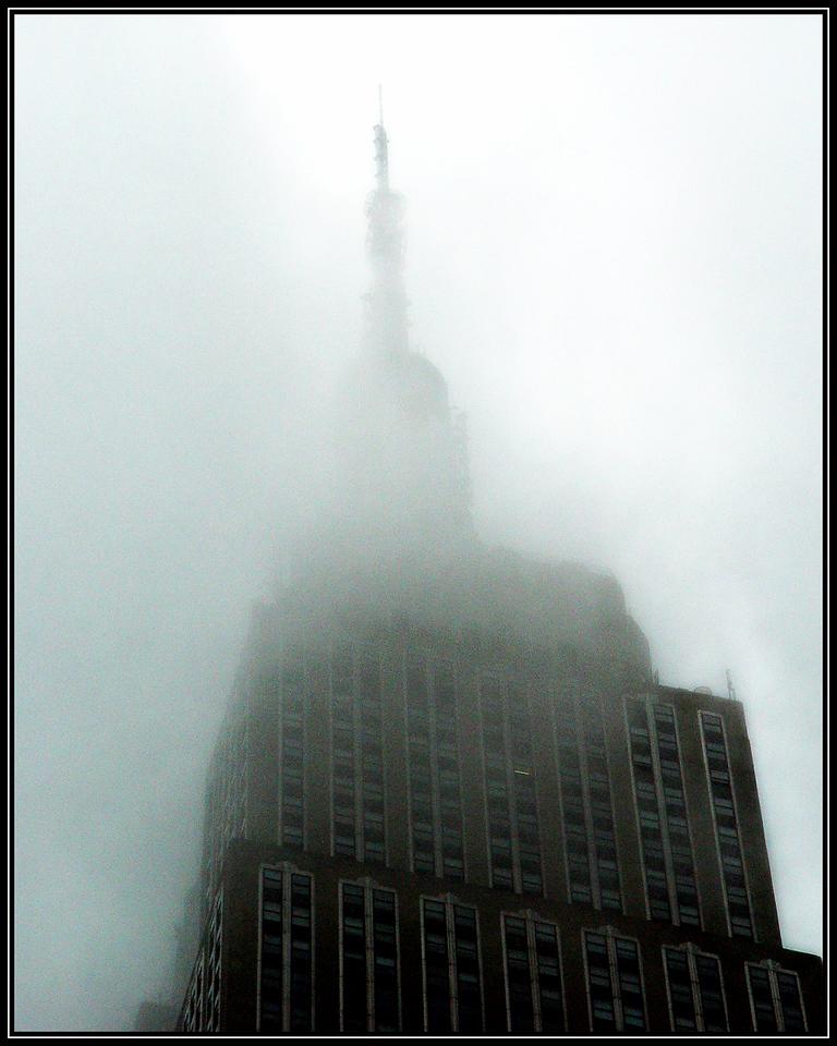 Empire State Building enveloped in fog