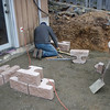 The retaining wall has to go in before final prep of the patio.