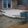 """As I placed the 12""""X 12"""" stones I put down a thin layer of loose sand so I can level the stones."""