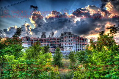 Sun setting over a dilapidated Fisher Body Plant #21 in Detroit