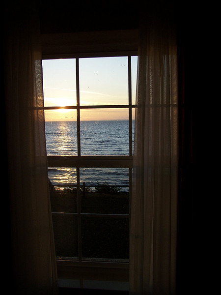 Window view of sunrise over Lake Superior at Munising, Michigan's Americinn.