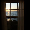 Window view of sunrise over Lake Superior at Munising, Michigan's Americinn.