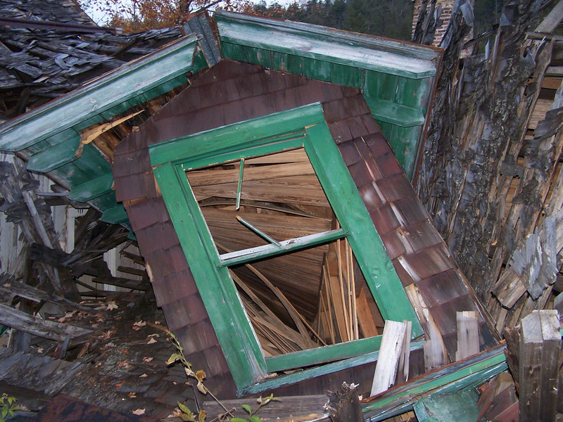 Green window of a home destroyed by storms in Kentucky