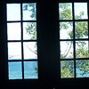 View through the windows from inside the Au Sable fog signal building of the Grand Sable Dunes
