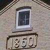 Cream City brick exterior of the Port Washington Lighthouse