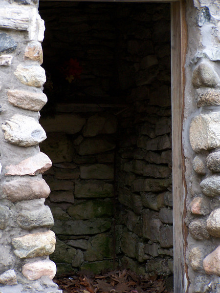 View through doorway of the interior of a stone storage building in the Baileys Harbor cemetery in Door County, Wisconsin.