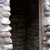 View through doorway of the interior of a stone storage building in the Baileys Harbor cemetery in Door County, Wisconsin.