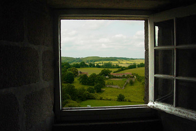 Looking out a window of Chateau La Flocelliere at the French countryside.