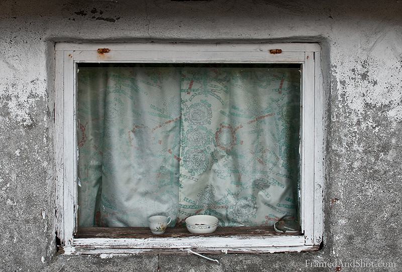 <strong><Center>Old Window<br> Images like this alway make us wonder – what does it look like inside, who live (or rather lived) here….. This charming old window belongs to a little cabin, at Tungenes at the west coast of Norway