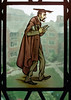 A caricature of a lawyer, holding several books, who is walking. In the background, the quadrangle of the law school is visible through the old, stained glass window. Note that a bit of extra border was left around the edge to provide context for the image and can be trimmed off.