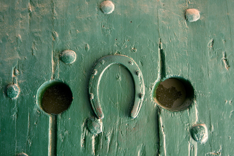 An upside-down horseshoe that is nailed to a prison cell door in the Castle of Good Hope in Cape Town, South Africa. This symbol is often taken to mean that someone's luck has run out such as in this case when prisoners were taken to the torture chamber in the castle.