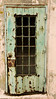 A rusty door at the old Alcatraz maximum security prison in San Francisco. This door, once painted green, has rusted out over the years due to a lack of maintenance and is now a symbol of neglect.