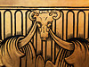 Decorative detail from the inside of a meeting room at the International Peace Palace in The Hague with what appears to be a pattern with various robes draped around a ram's skull.