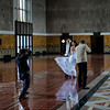 LA Union Station Special Event Room with Bride and Groom Posing for Wedding Photographs.<br /> Note Bride's Reflection on the Floor
