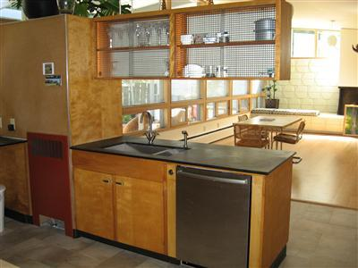 kitchen, sink side, family room beyond (realtor photo)