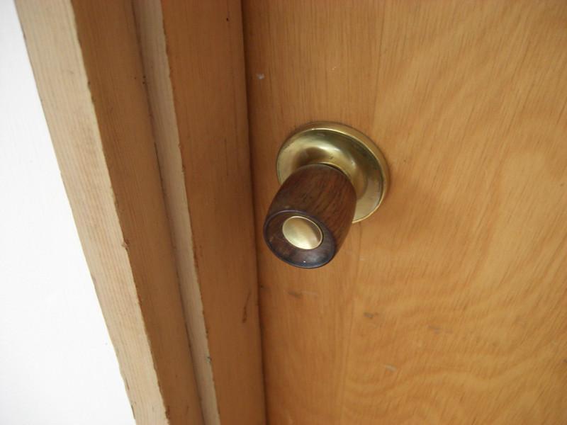 typical door hardware, brass and walnut