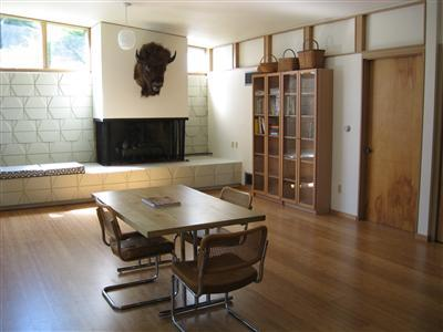 "family room off kitchen (realtor photo)<br /> I've since learned that is ""Buffalo Bill"" on the fireplace."