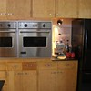 kitchen, new Viking ovens in cool, original cabinets!<br /> --I don't know why the one drawer is darker than other but since it is, that's where we keep the coffee beans (easy to find in the morning!)