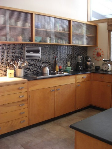 the kitchen<br /> --the only updates are the countertops (black Richlite), appliances, and glass tile back-splash (oh, and our cool, orange Nelson clock)