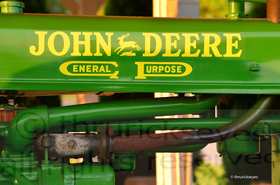 A closeup of the motor of the John Deere tractor they have on display at the top of the hill by the horse barn.