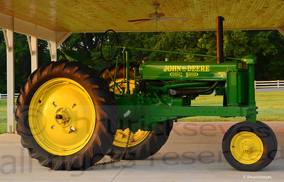 The John Deere tractor they have on display at the top of the hill by the horse barn.