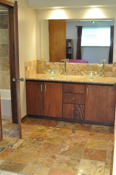 Master Bath Remodel - Design and Construction, Travertine Floor and Backsplash, Mahogany Cabinets,  Granite Counter Top, Dual Glass Vessel Sinks.