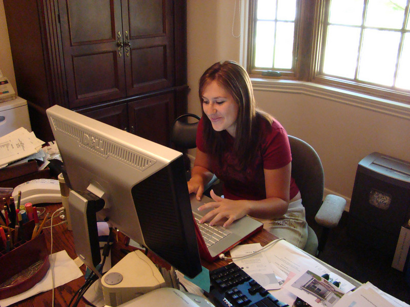 Jessie is setting up a DVD slideshow of the house from demo to completion, to run on the den TV during the party