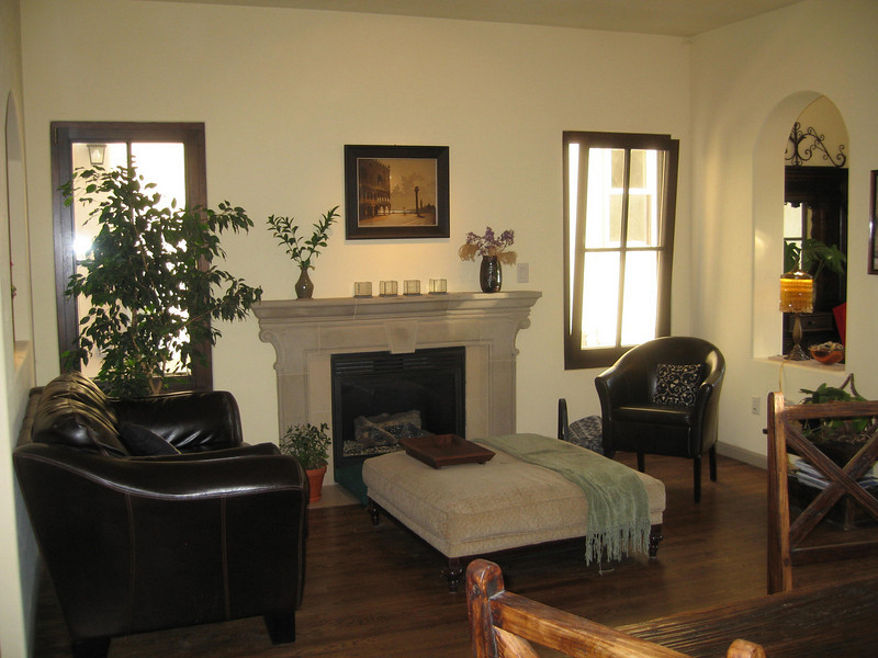 Cast Stone Fireplace flanked by German Tilt-and Turn windows.