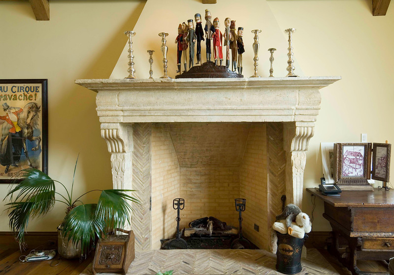 Tranditional brick and limestone, open front fireplace, is a sensitive yet strong focal point in Cherry Hills Family Room..
