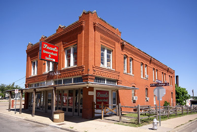 Built in 1909 this building was the Stockyards Branch Post Office.  The upper floor was a boarding house.  It has served many functions over the years.