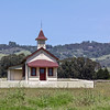 Old School House - San Simeon, CA. Hearst Castle in upper right.