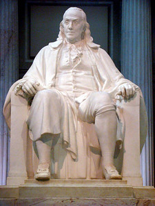 Benjamin Franklin National Memorial — located in the rotunda of The Franklin Institute in Philadelphia, Pennsylvania — features a colossal seated statue of Benjamin Franklin. The 20-foot  high memorial, sculpted by James Earle Fraser between 1906 and 1911, honors the writer, inventor and American statesman. The statue weighs 30 short tons  and sits on a 92-short-ton  pedestal of white Seravezza marble. The statue is the focal piece of the memorial hall, designed by John T. Windrim after the Pantheon, dedicated in 1938. Congress designated the national memorial on October 25, 1972 . Unlike most national memorials, the statue is not listed on the National Register of Historic Places.