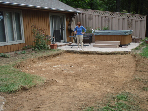 Excavated area between porch/deck and hot tub patio.