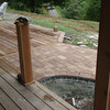 The new walkway is flush with the wood porch and deck.