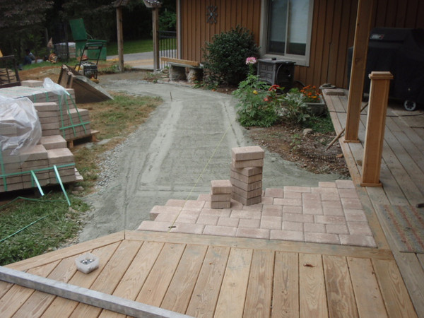 The beginnings of the walkway. It is a very gradual incline from the driveway to the front porch.