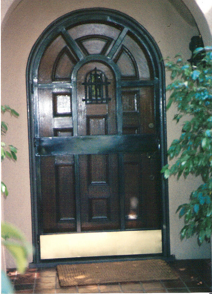 Arched security screen door - Bumbstead residence, San Marino, CA