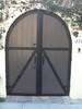 Rounded gate - Atencio residence, Los Feliz, CA