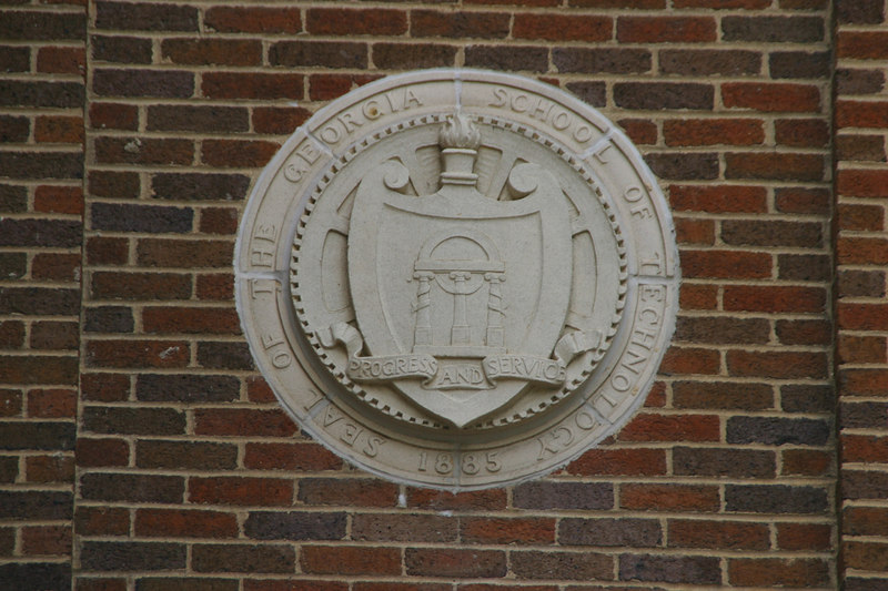 """Before it was an """"Institute,"""" it was just a school.  The Coon Building has several of these seals embedded into the brick."""