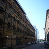 May 2012. Glasgow city centre. Looking along James Watt Street towards the Clyde, in among some of the last remaining warehouses. That on the left is a propped-up facade. That on the right is now flats.