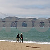 People walk along the beach during a celebrattion of the 75th anniversary of the Golden Gate Bridge in San Francisco, California, on May 27, 2012. UPI/David Yee