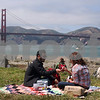 Edison Cruz (L) and Sara Friden, both of San Francisco share a picnic lunch together at Crissy Field during the 75th anniversary celebration of the Golden Gate Bridge in San Francisco, California, on May 27, 2012. UPI/David Yee
