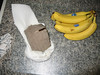 fallen piece of building -- back side - shown next to bananas for size comparison