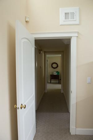 """guest bedroom hallway,  looking into old garage and edge of door to """"mudroom"""""""