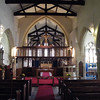 Looking down the nave, the suspended screen and decorations above.
